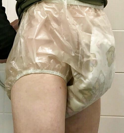 Plastic pants blowjob