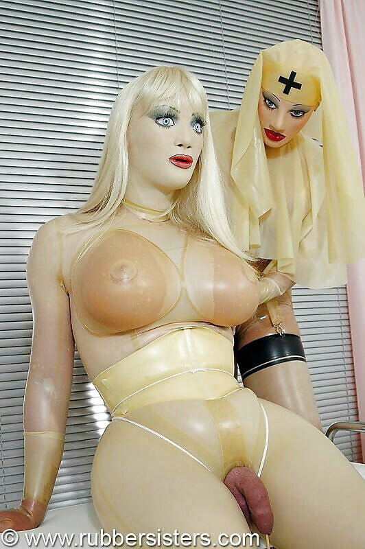 Rubber doll in latex condom suit