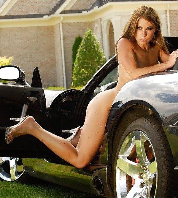 Naked Woman Sitting On White Car Hood