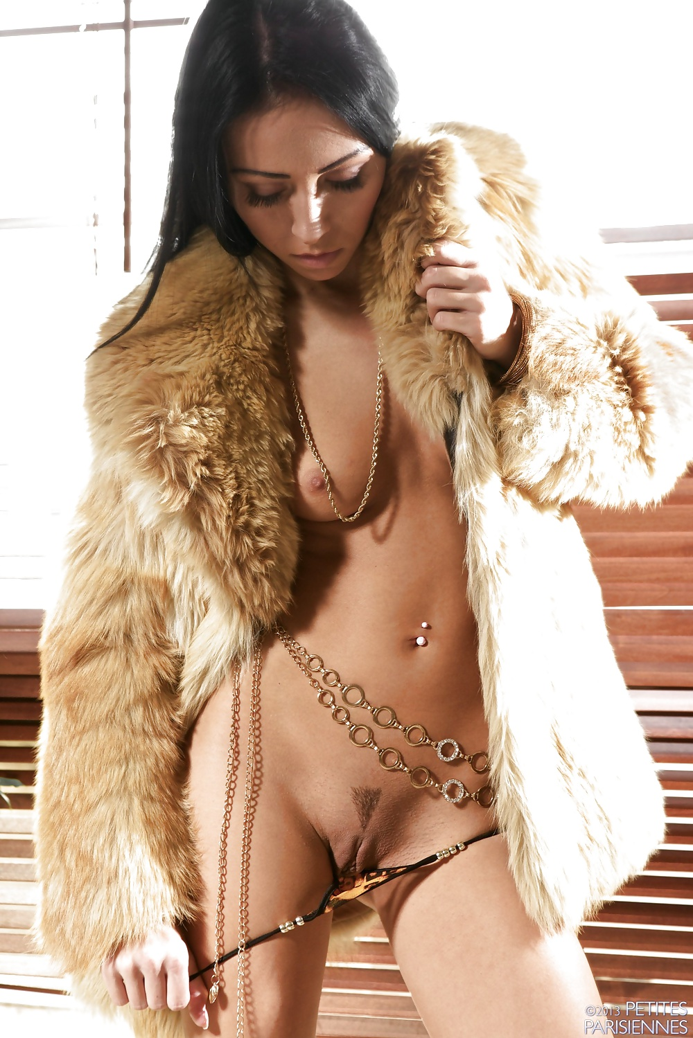 Naked Girl Is In A Fur Coat Stock Photo