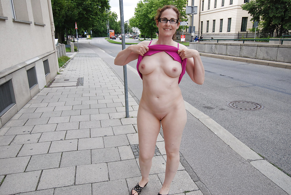 Hot Mother Positions Nude In A Public Street