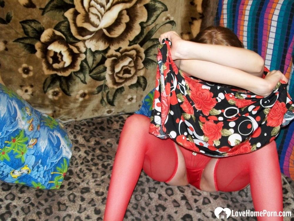 Hottie tries on some red lingerie and masturbates - 40 Pics